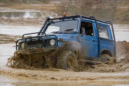 wade: Driver competing in an off-road 4x4 competition