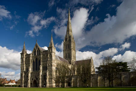 prayer tower: View of Salisbury Cathedral in England with blue sky and white clouds Stock Photo