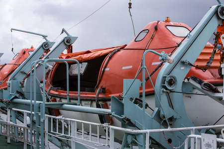lifeboats: Brightly coloured Lifeboats secured on a ferry Stock Photo
