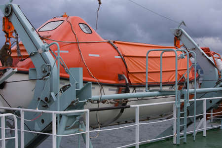 lifeboat: Brightly coloured Lifeboats secured on a ferry Stock Photo