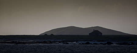 croft: Lonely South Uist cottage next to a loch in the Outer Hebrides Stock Photo