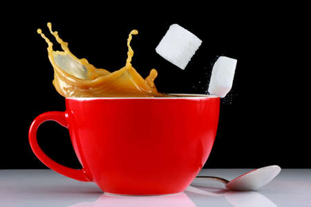 Coffee splash with sugar cubes photo