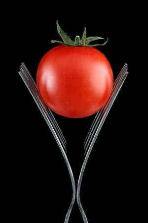 Tomato on forks