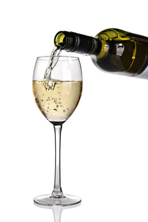 white wine: White wine being poured into glass.