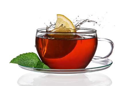 Lemon splashing into tea Stock Photo
