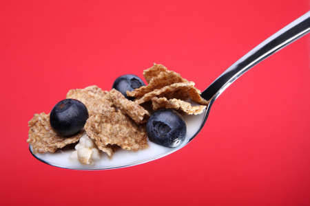 Wholeweat cereal on spoon with blueberries Stock Photo - 7822642