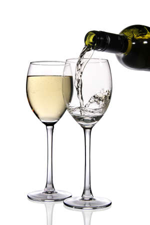 white wine bottle: White wine being poured into glass