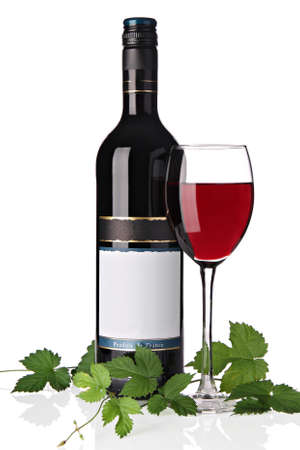 Bottle of red wine, with single glass of wine