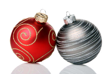 red sphere: Two christmas baubles, isolated on a white background         Stock Photo