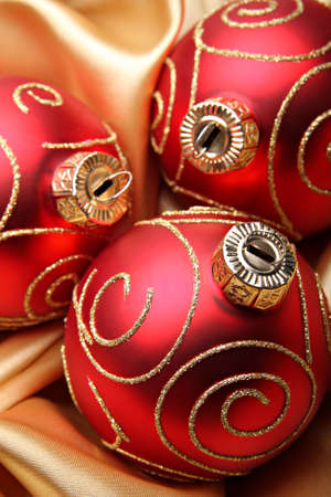 Three red christmas baubles photo