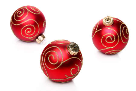 Red christmas baubles, isolated on a white background      版權商用圖片