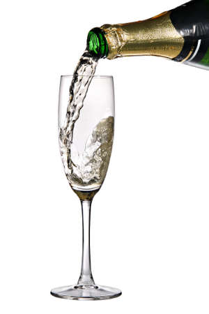 Champagne. Champagne being poured into glass, isolated on a white background photo
