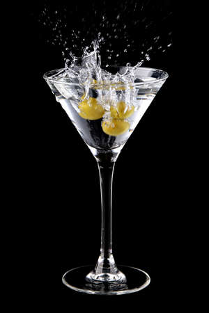Martini cocktail with olives and splash Stock Photo - 8204088