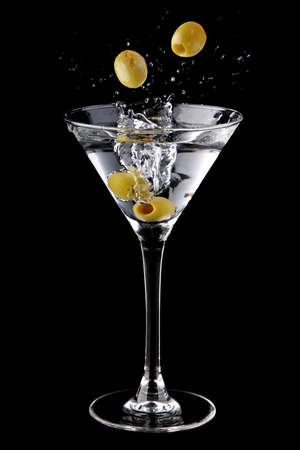 martini: Martini cocktail with olives and splash Stock Photo