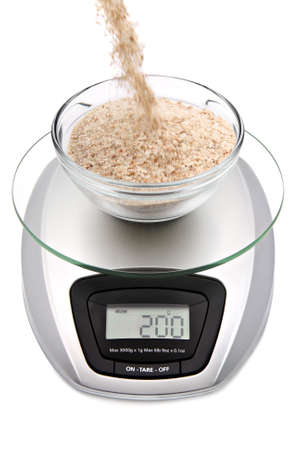 bran: Digital kitchen scale with bowl of oat bran