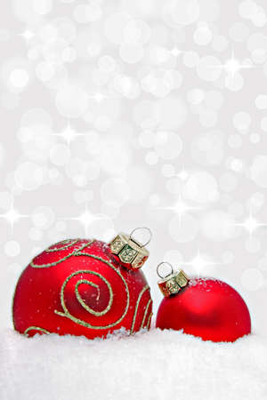 Two christmas baubles with bokeh light effect Stock Photo - 8383117