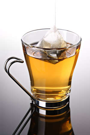 Cup of tea with pyramid teabag (concept) Stock Photo - 8802569