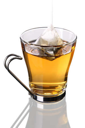 Cup of tea with pyramid teabag  Stock Photo - 8802563