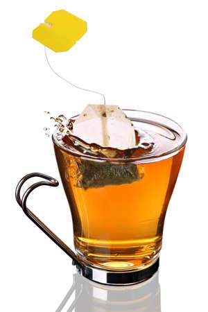 tea time: Tea bag splashing into cup of tea  Stock Photo