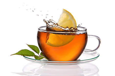 Cup of tea with lemon and splash photo