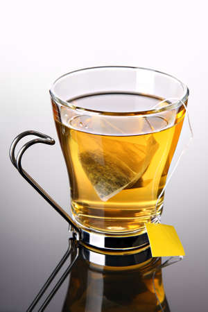 Cup of tea with pyramid teabag (concept) Stock Photo - 9282102
