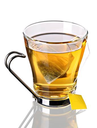 Cup of tea with pyramid teabag (clipping path included) Stock Photo - 9282101