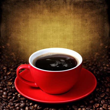 red cup: Cup of coffee on grunge textured background Stock Photo
