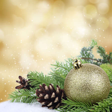 fir cones: Christmas bauble border on golden background Stock Photo