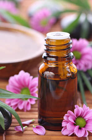 aromatherapy oils: Aromatherapy bottle and purple flowers