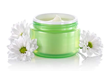 moisten: Cosmetic face cream container with white daisies Stock Photo