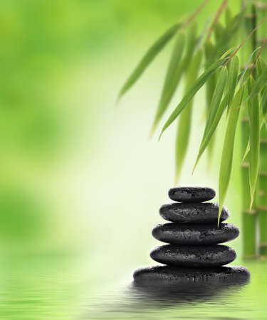 Tranquil zen design with stacked massage stones and bamboo photo