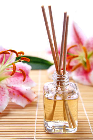 Fragrance sticks or Scent diffuser with lily flowers Stock Photo