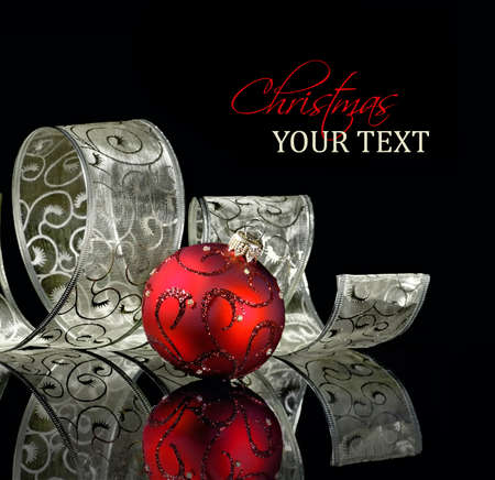 Christmas ornament with curled ribbon on a black background photo