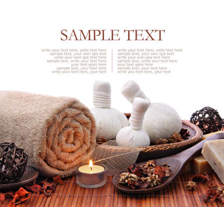 Spa massage border background with towel and compress balls Standard-Bild