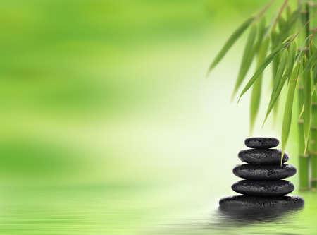 Spa background with stacked massage stones Standard-Bild