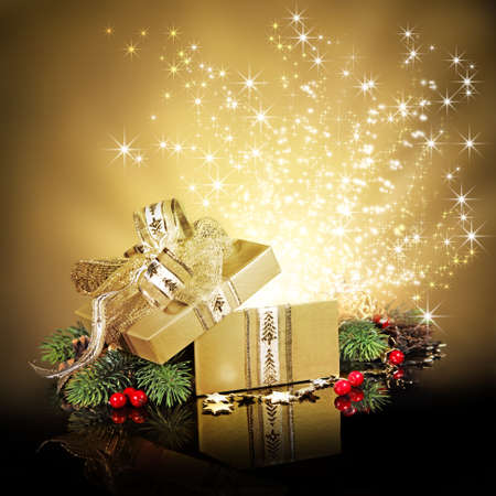 Christmas surprise gift box or present, exploding with glitters and stars against a festive holiday background Standard-Bild