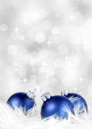 Blue ornaments on billowy feathers against a silver background