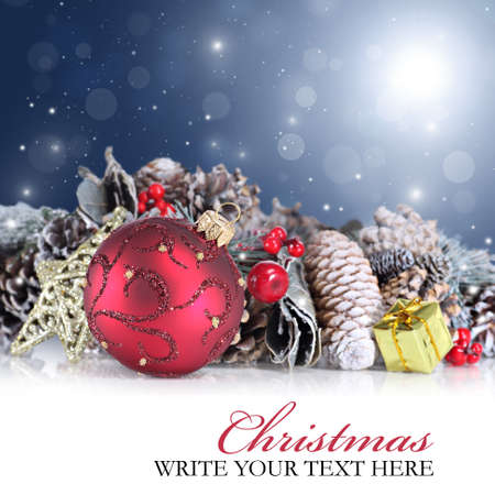 Christmas background with red ornaments against a festive sparkling background Standard-Bild