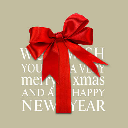Merry Christmas greetings typography with red ribbon