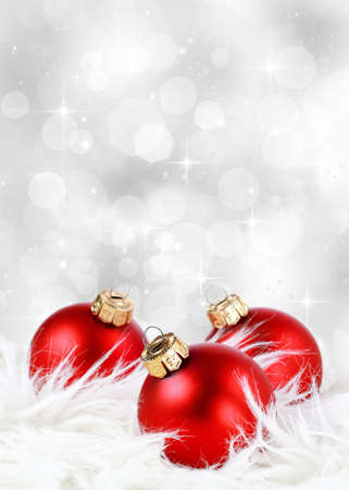 Christmas background with red ornaments against a festive sparkling silver background Standard-Bild
