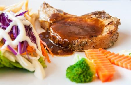 Pork steak with black pepper photo