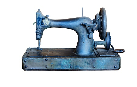 isolated antique sewing machine on white photo