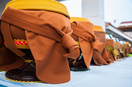 deeds: Giving alms to a monk is one of the ways to make money .  Merits Buddhists believe that these good deeds will lead to a better life with more happiness and wealth. Stock Photo