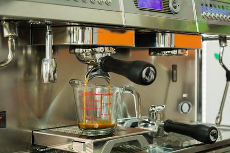 Professional coffee machine making espresso in a cafe photo