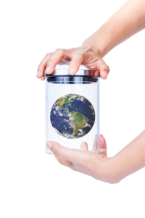 earth in a jar on white background, concept global warming. photo