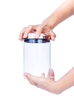 Close up of hands opening a jar. Stock Photo