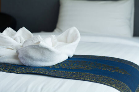 White clean towels on the hotel bed photo