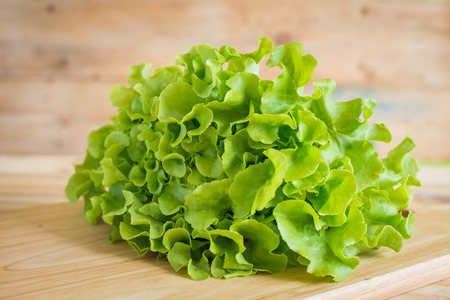 residue: closeup fresh lettuces on wooden desk , pesticide residue free Stock Photo
