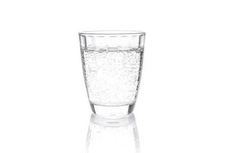 Transparent carbonated drink poured into a transparent container, shot on white background. 스톡 콘텐츠
