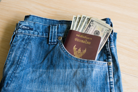 Thailand Passport And Silver Dollar In The Pocket Jeans Stock ...